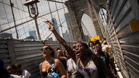 Protesters in support of Trayvon Martin march across the Brooklyn Bridge after attending a rally organized by the Rev. Al Sharpton on Sunday in New York City.