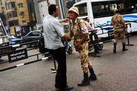 A pedestrian greets a member of the Egyptian military in Cairo's Giza district on the morning after the president Mohammed Morsi was ousted from power and put under house arrest.