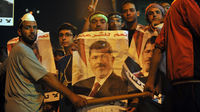 Egyptian supporters of ousted President Mohammed Morsi demonstrate against the military-backed government in Cairo. Morsi, who has been detained since July 3, is in good health, a European official says.