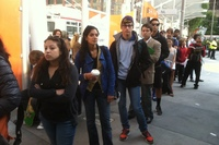 Frustrated commuters wait at the Transbay Temporary Terminal in San Francisco to catch a bus over to Oakland Tuesday.