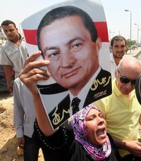 A supporter of former Egyptian President Hosni Mubarak celebrates his release from prison on Thursday. He's still under house arrest while awaiting retrial on various charges.