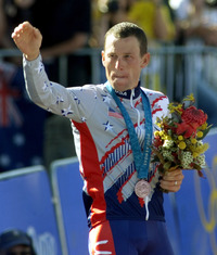 Lance Armstrong celebrates on the podium after winning the bronze medal in the men's individual time trial of the 2000 Summer Olympic Games in Sydney, Australia, on Sept. 30, 2000. On Wednesday, Armstrong returned the medal because of his use of performance enhancing drugs.
