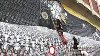 News of U.S. surveillance in Europe has met with distrust and anger; officials are heading to Washington to discuss matters next week. Here, members of an artists' group paint a mural called 'Surveillance of the Fittest' on a wall in Cologne, Germany, Thursday.