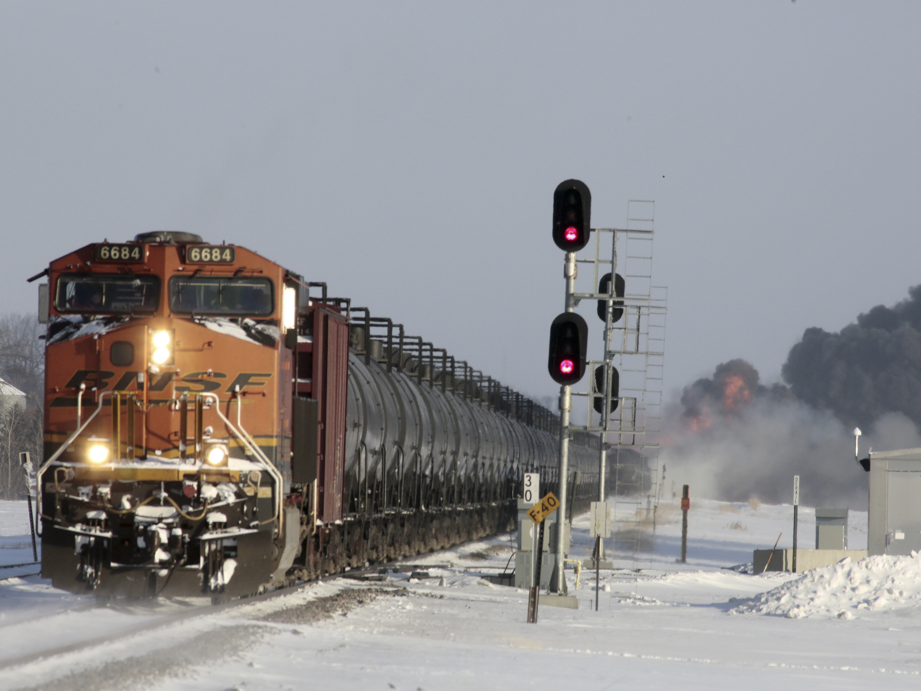 A plume of smoke rises from scene of a derailed train near Casselton, North Dakota, on Monday.