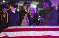 Clara Gantt, the 94-year-old widow of U.S. Army Sgt. Joseph Gantt, weeps in front of her husband's casket.