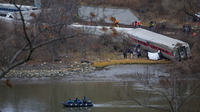 Search and rescue teams work at the scene of Sunday's passenger train crash in the Bronx. The train crash killed four people and injured dozens more.