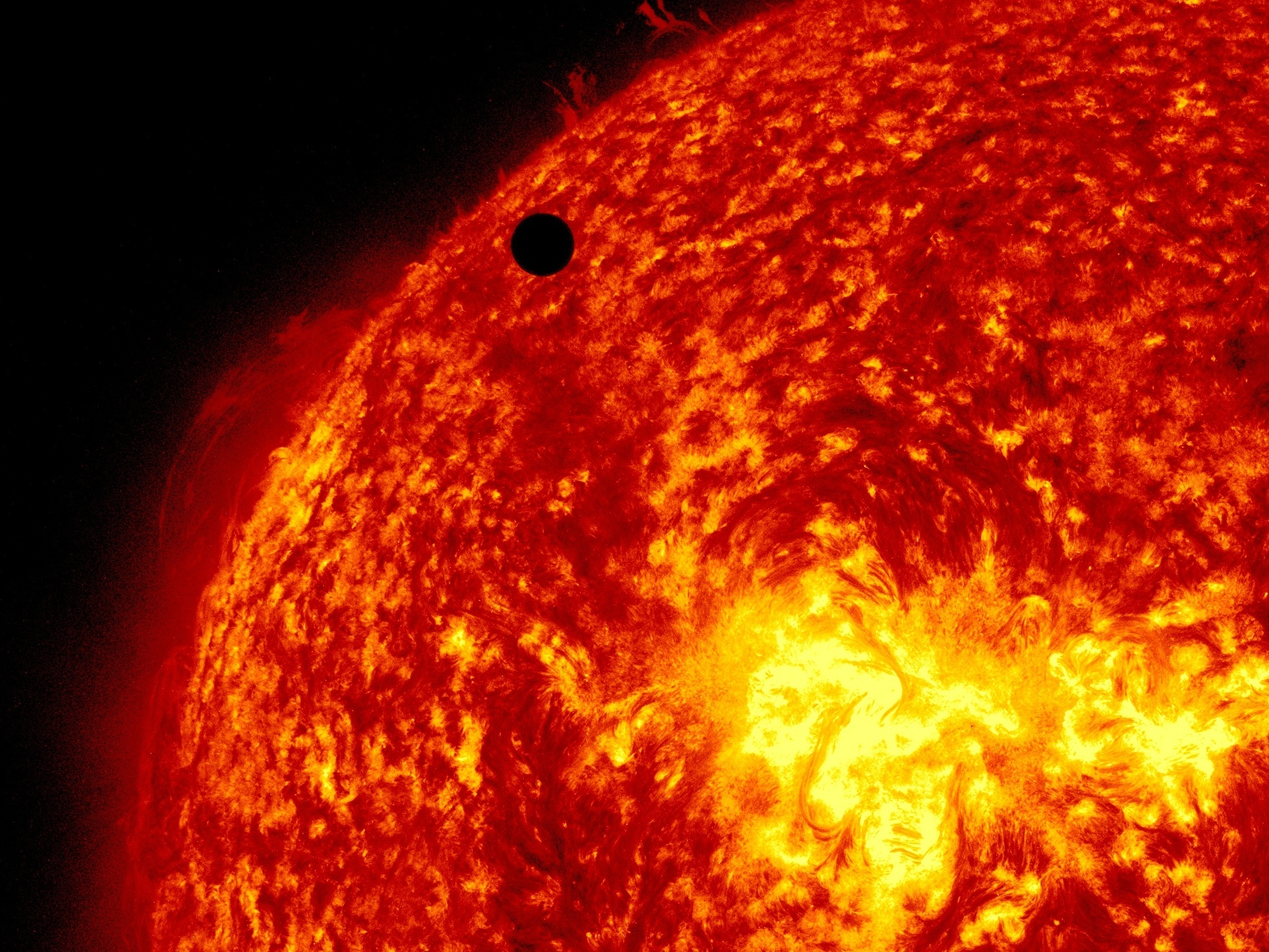 A view of Venus, black dot at top center, passing in front of the sun during a transit in 2012. A quarter of Americans questioned failed to answer  correctly the most basic questions on astronomy.