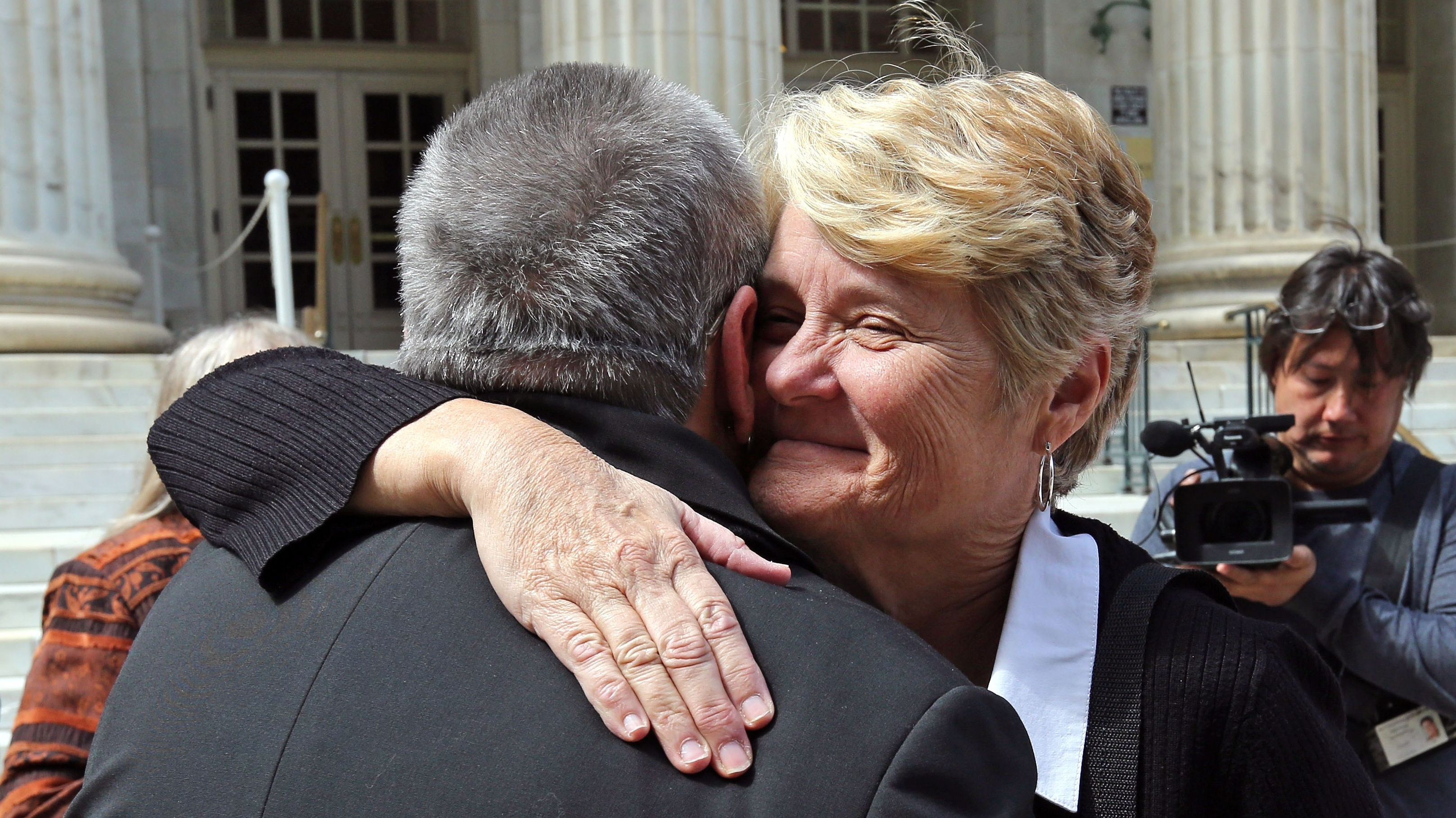 Sue Barton, a plaintiff challenging Oklahoma's gay marriage ban, gets a hug from her pastor following a hearing at the 10th U.S. Circuit Court of Appeals in Denver, Thursday on April 17