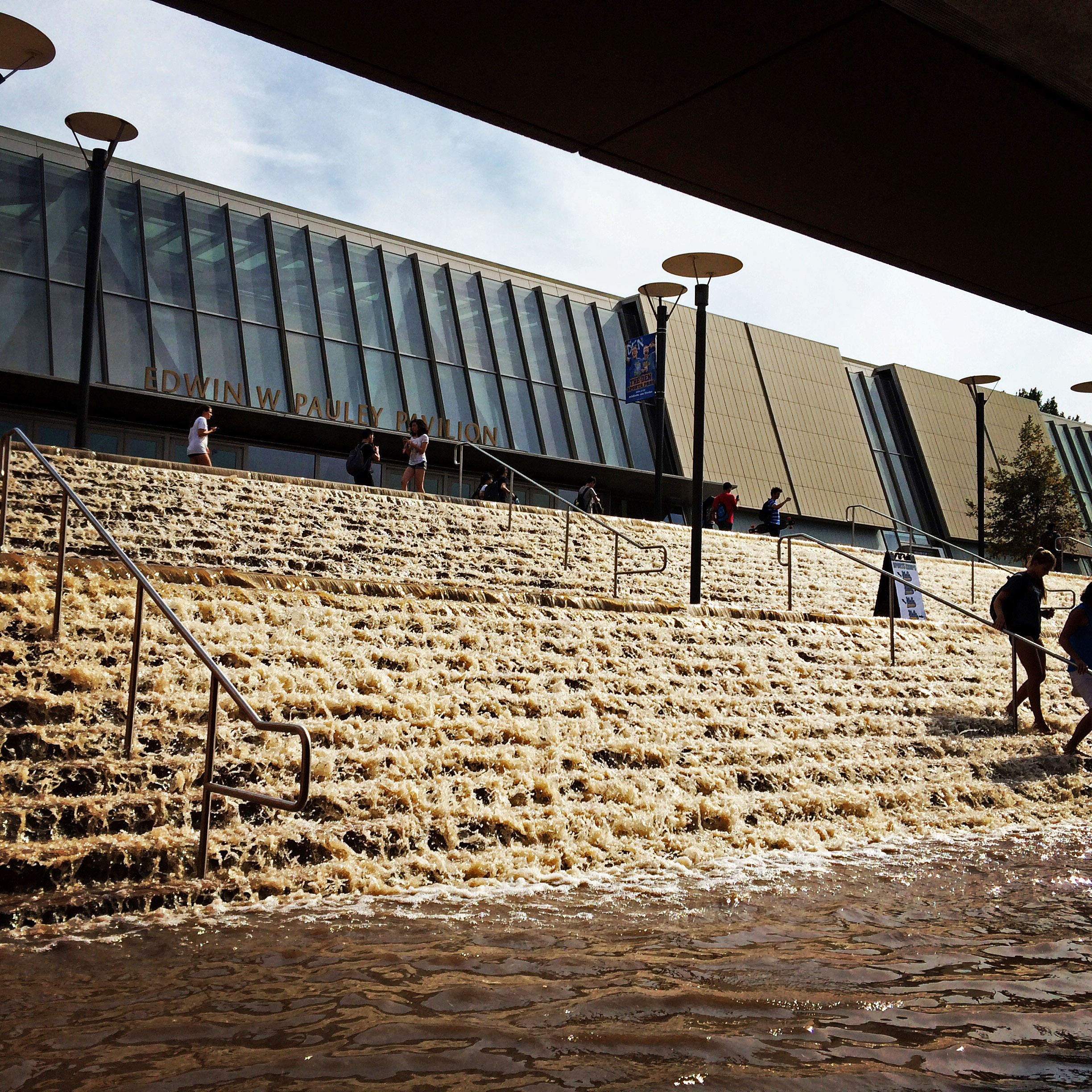 Water cascades down a stairway to a parking structure adjacent to Pauley Pavlion, home of UCLA basketball.