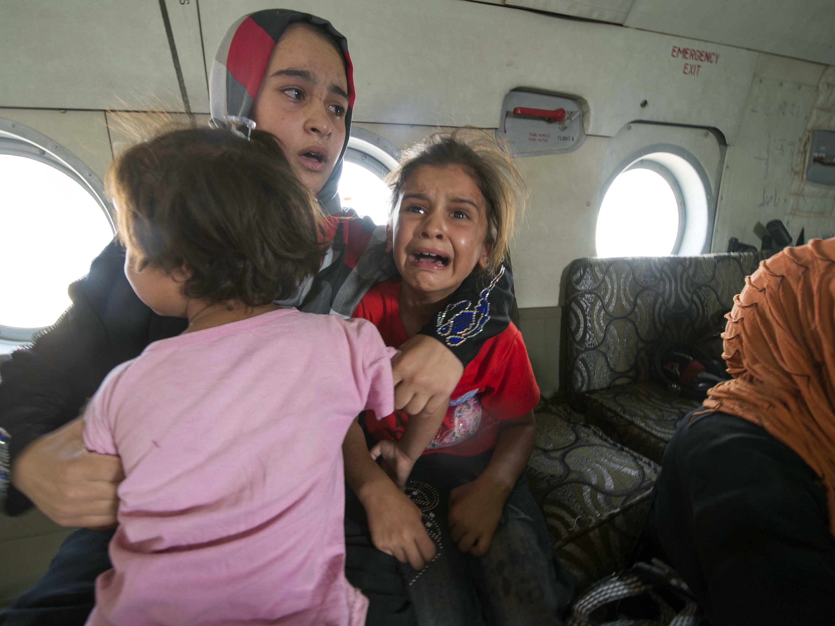 A woman and children in a military helicopter after being evacuated by Iraqi forces from Amerli, north of Baghdad late last week.