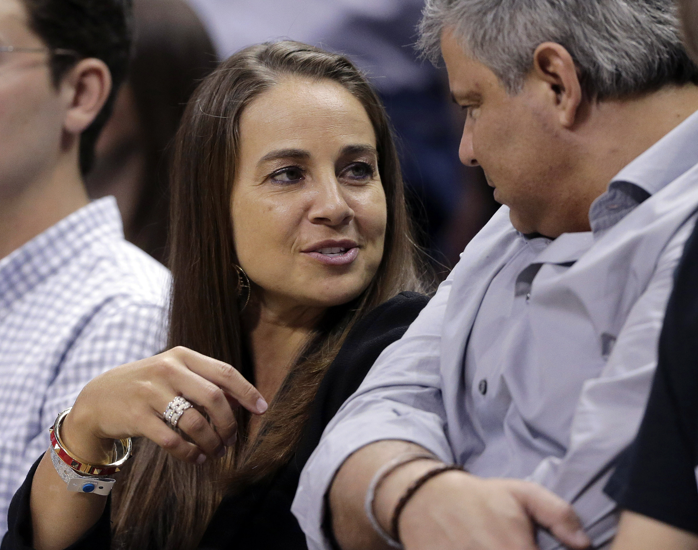 The San Antonio Stars' Becky Hammon, seen here attending a Spurs playoff game, has been hired as a full-time assistant coach, joining the NBA's reigning champions for next season.
