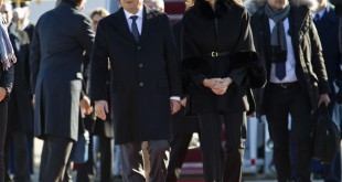 French President François Hollande is accompanied by U.S. Deputy Chief of Protocol Natalie Jones, upon his arrival at Andrews Air Force Base, Md., on Tuesday.