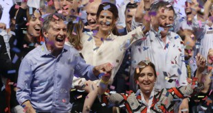 Opposition presidential candidate Mauricio Macri, left, and running mate Gabriela Michetti celebrate after winning a runoff presidential election in Buenos Aires, Argentina, on Sunday.