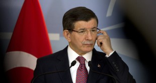 Turkish Prime Minister Ahmet speaks during a media conference at NATO headquarters in Brussels on Monday.