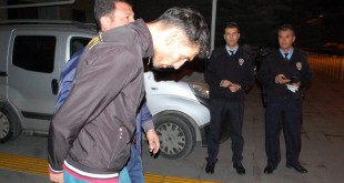 Anti-terror police detain a man identified as Ahmet Dahmani, an alleged ISIS member, in Antalya, Turkey, Saturday. One of three people arrested, Dahmani is accused of scouting locations for last week's terror attacks in Paris.