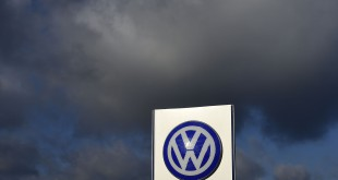 The Volkswagen logo is seen at the main entrance gate of the Volkswagen group on Friday in Wolfsburg, Germany. That day, CEO Matthias Mueller announced the company would be cutting expenditures by more than $1 billion.