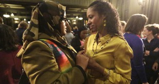 Wheaton College associate professor Larycia Hawkins (right) is greeted by supporter Donna Demir after a news conference on Jan. 6 in Chicago. Hawkins, who's Christian, was suspended by Wheaton, an evangelical Christian school, after she said Muslims and Christians worship the same God. Administrators initiated steps to fire her. On Saturday the professor and school announced they'd parted ways.