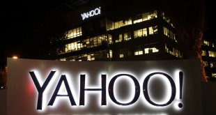 Yahoo is addressing continued losses with layoffs and other cuts.