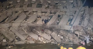 Rescuers are seen entering an office building that collapsed on its side from an early morning earthquake on Saturday in Tainan, southern Taiwan. A 6.4-magnitude earthquake has struck southern Taiwan, according to the U.S. Geological Survey.