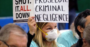 On Jan. 16, Tera Lecuona, resident of the Porter Ranch area of Los Angeles, holds a protest sign during a hearing over a gas leak at Southern California Gas Company's Aliso Canyon Storage Facility. The company faces misdemeanor charges as well as numerous civil lawsuits.