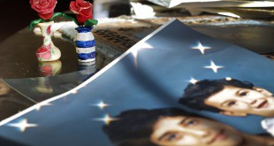 On Dec. 10, 2014, prison artwork created by Adnan Syed sits near family photos in the home of his mother, Shamim Syed, in Baltimore. Syed, convicted in 2000 of murdering his girlfriend, is appearing at a hearing Wednesday to request a new trial, based on evidence uncovered by the podcast Serial.