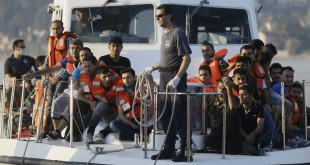 NATO on Thursday ordered a naval force to move immediately to the Aegean Sea to help end the deadly smuggling of migrants between Turkey and Greece. In this photo from last June, a Greek coast guard vessel arrives carrying migrants at the port of Mytilene, Greece, after a rescue operation.