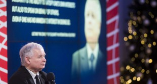 Jaroslaw Kaczynski sits before a large image of his twin brother, Lech Kaczynski, who was the president of Poland from 2005 until his death in a plane crash in 2010. Today Jaroslaw Kaczynski, a former prime minister of Poland, doesn't hold political office; but as the head of the Law and Justice party, he is functionally the leader of Poland.