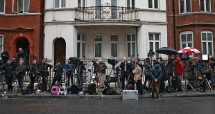 Journalists work outside the Ecuadorian embassy where WikiLeaks founder Julian Assange has been holed up since 2012. A UN panel says he deserves compensation for being arbitrarily detained.