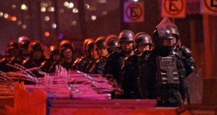 Riot police were deployed outside Topo Chico prison in Monterrey, Mexico, last night, where at least 52 people died in rioting and a fire.