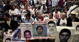 Parents and other relatives of the 43 missing students from the Ayotzinapa's teachers school attend the reading of the final report from the Interdisciplinary Group of Independent Experts (GIEI) in Mexico City on Sunday.