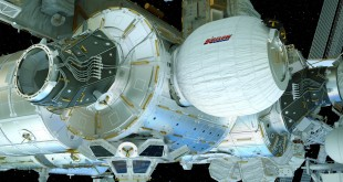 An artist's concept shows the Bigelow Expandable Activity Module (BEAM) as it would look when fully installed and inflated on the International Space Station.