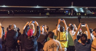 Spectators turned out to watch the Solar Impulse 2 solar airplane land at Phoenix Goodyear Airport Monday night.