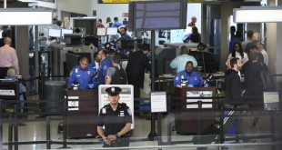 TSA agents work at a security checkpoint at Newark Liberty International airport in New Jersey on Monday. The House committee says the head of security for TSA has been removed from office after inquiries into the agency's management.