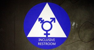 A new sticker designates a gender neutral bathroom at a high school in Seattle. President Obama's directive ordering schools to accommodate transgender students has been controversial in some places, leading eleven states to file a lawsuit against the Obama administration in response.