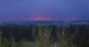 The size of the fires around Fort McMurray, Alberta, is now more than 210,000 acres. The blaze is seen here from a distance on Thursday. The Province of Alberta is under a state of emergency.