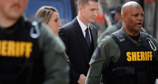 Officer Edward Nero (center) arrives at court in Baltimore on Monday. Nero has been found not guilty of multiple misdemeanor charges in connection with the death of Freddie Gray.