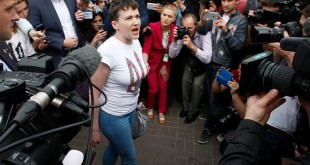Ukrainian pilot Nadiya Savchenko (center), who was freed from jail in Russia as part of a prisoner exchange, talks to the media upon arrival at Kiev's Boryspil airport on Wednesday.