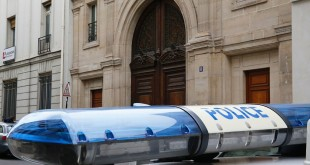 A police car sits outside Google's offices in Paris on Tuesday as authorities carry out a search as part of a tax fraud investigation.