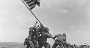 In this Feb 23, 1945, photo, Marines of the 28th Regiment, 5th Division, raise the U.S. flag atop Mt. Suribachi on Iwo Jima. After more than seven decades, Navy Corpsman John Bradley will be replaced in captions by Pvt. 1st Class Harold Schultz.