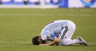 Argentina's Lionel Messi reacts after losing 4-2 to Chile in penalty kicks during Sunday's Copa America final in New Jersey.