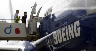 A Boeing logo is displayed on the fuselage of a Boeing 787-9 Dreamliner aircraft. The Chicago-based aircraft manufacturer would not divulge details about the deal with Iran Air — the number of aircraft involved, the specific models or the price tag.