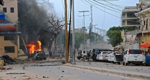 Fire is seen at the scene of a car bomb attack claimed by Al-Qaeda-affiliated Shabab militants on the Naasa Hablood hotel in Mogadishu on Saturday.