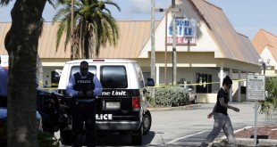 Officials investigate the scene of a deadly shooting outside the Club Blu nightclub in Fort Myers, Fla., on Monday.