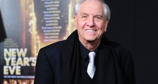 Director Garry Marshall poses on arrival for the film premiere of New Year's Eve in Hollywood in 2011. Marshall died at 81.