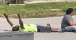 In a video filmed on Monday, Charles Kinsey (left) lies next to the autistic patient he was trying to help, holding his hands up in an effort to assure the North Miami police that they weren't a threat. Kinsey was later shot in the leg by the police.