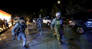 "Afghan security forces rush to respond to an attack on the campus of American University of Kabul on Wednesday. ""We are trying to assess the situation,"" President Mark English told The Associated Press."
