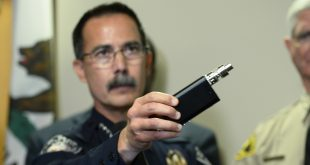 El Cajon, Calif., Police Capt. Jeff Davis holds up a vape device similar to the one that police say Alfred Olango was holding when he was shot on Tuesday. Davis held a news conference on Friday to release cellphone and surveillance video of the incident.
