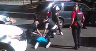 An image from video taken before, during and after the police shooting of Keith Lamont Scott by Charlotte police. The eyewitness video emerged Friday.