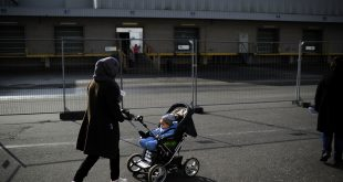 A woman from Afghanistan walks by a workshop at the shelter where they live in Sarstedt, Germany, in February.