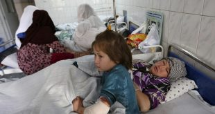 A girl named Farida, age 7, and her mother at a hospital after a militant attack on a Shiite shrine in Kabul, Afghanistan, on Oct. 12.